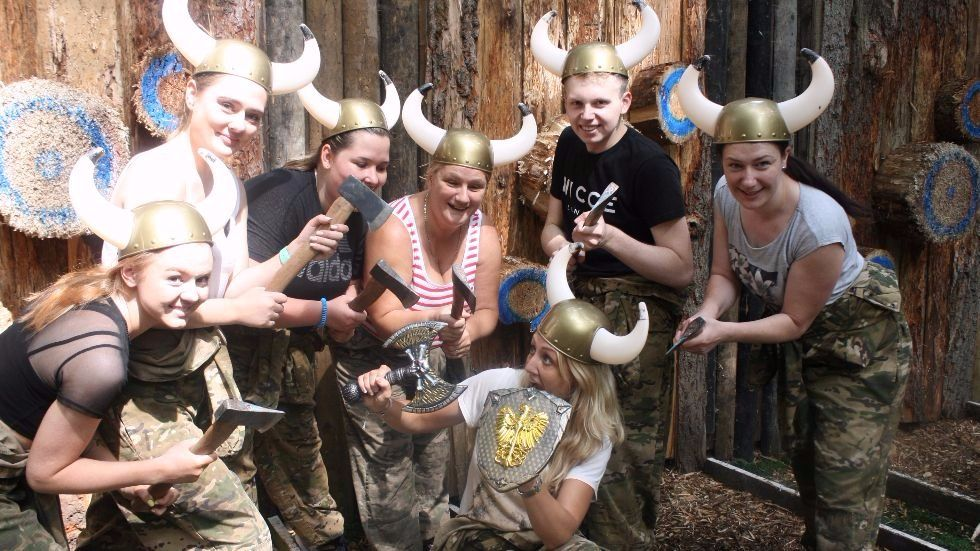 hen group of axe throwers wearing viking hats