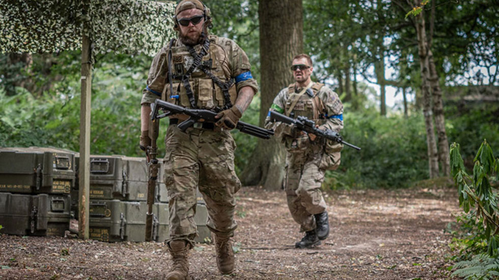 two airsoft players in woodland scenario
