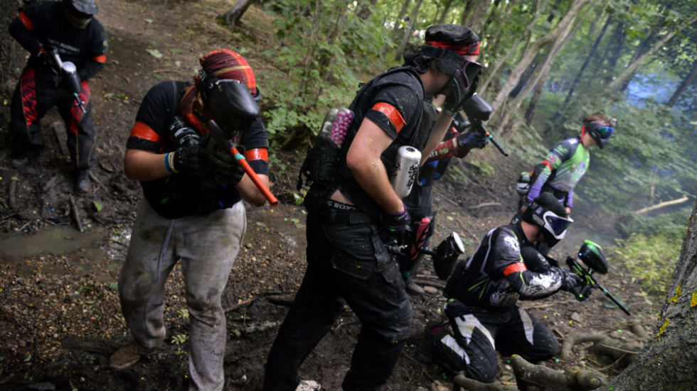 group of paintballers in action