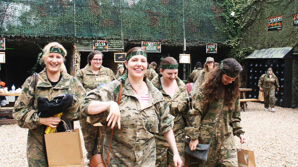 happy hen party group after playing paintball