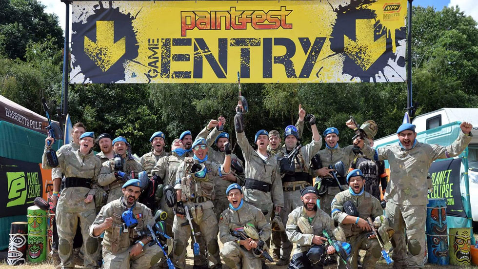 group of paintballers outside large paintfest sign