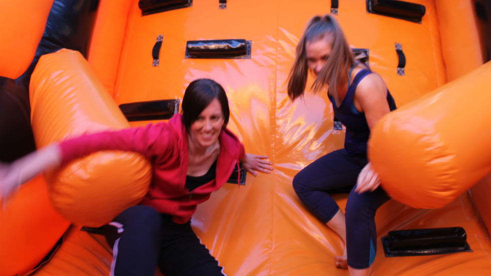 two players on inflatable slide