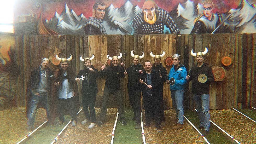 stag group in viking outfits with throwing axes