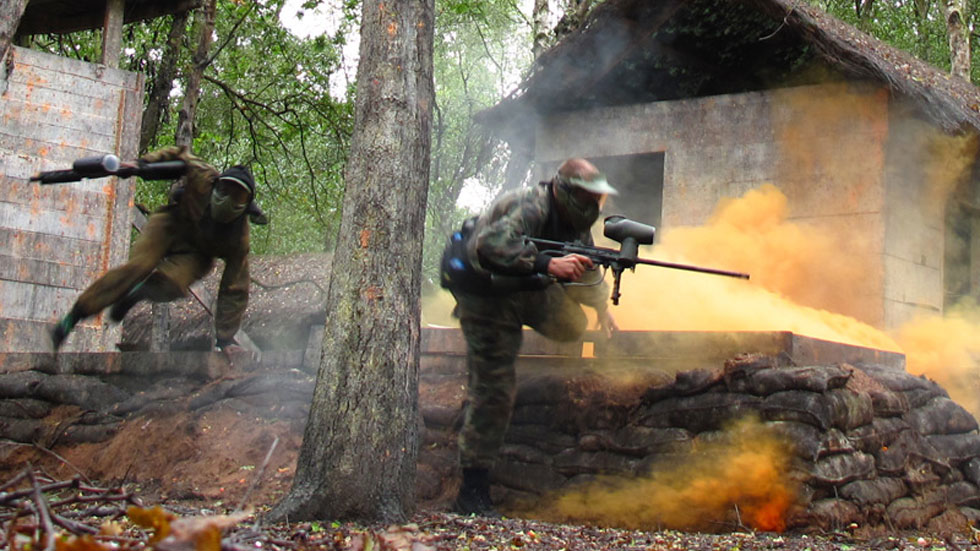 paintballers attacking woodland base