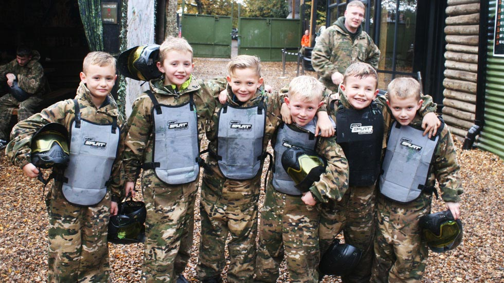 junior paintballers wearing body armor