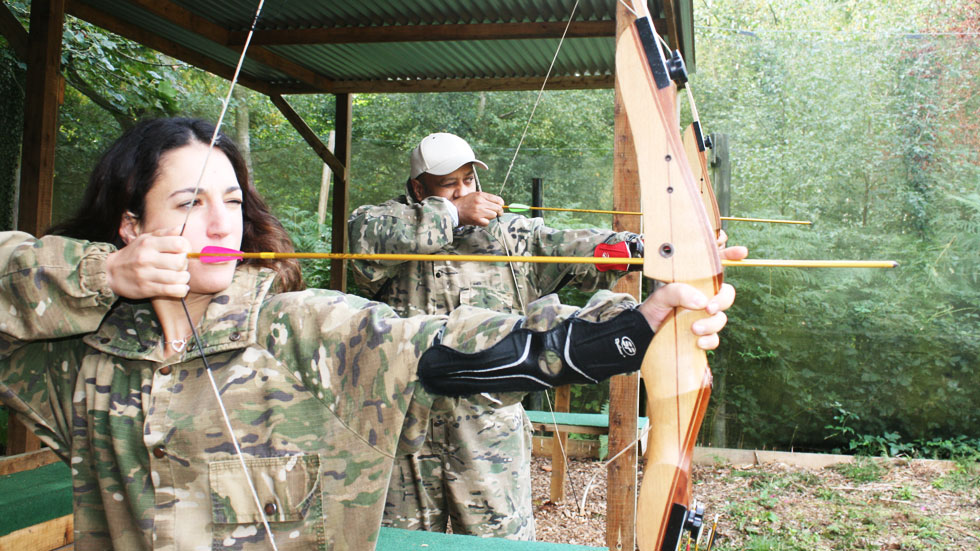 group with bows at archery range