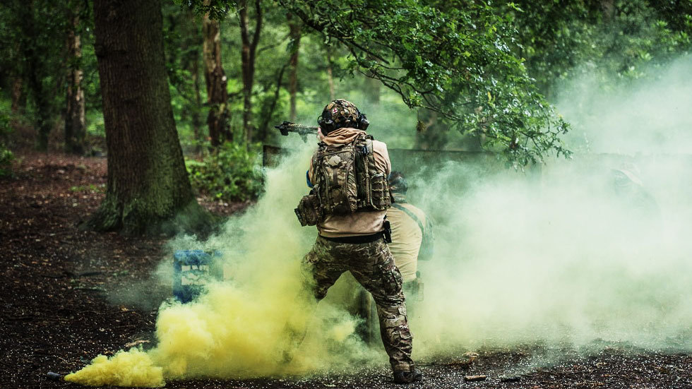 two players using smoke as cover
