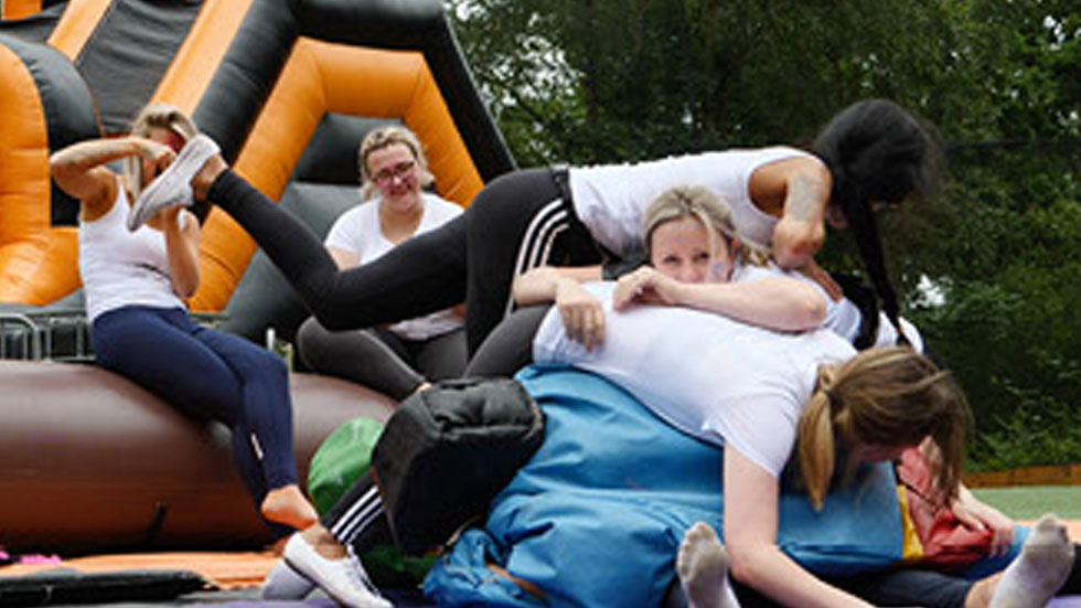 group of hens having fun with inflatables