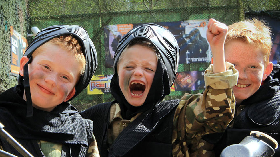 young players having fun in paintball gear