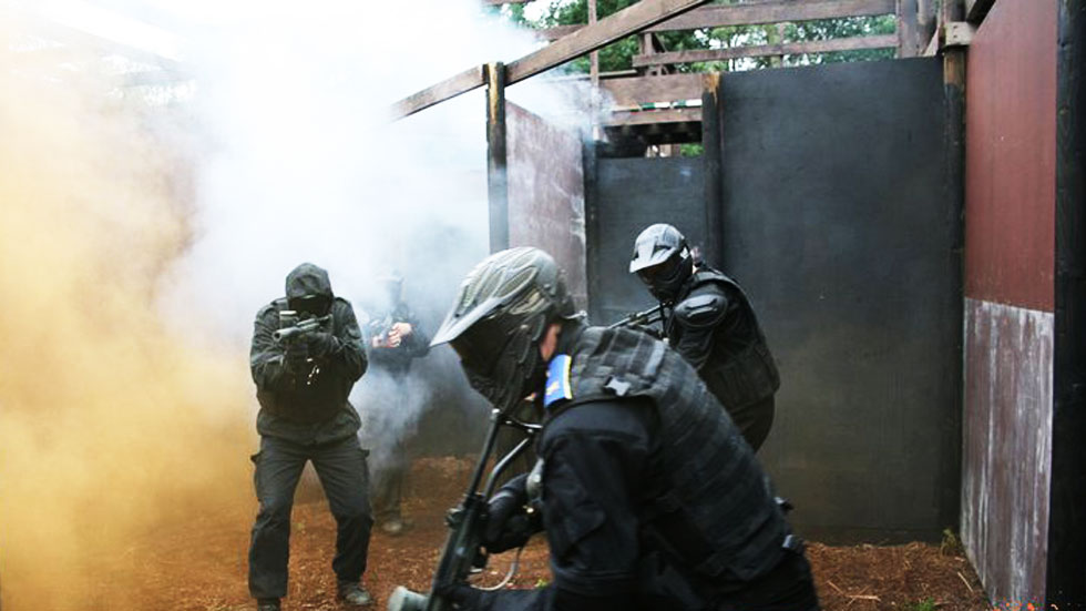 players shooting in smoke grenade cover