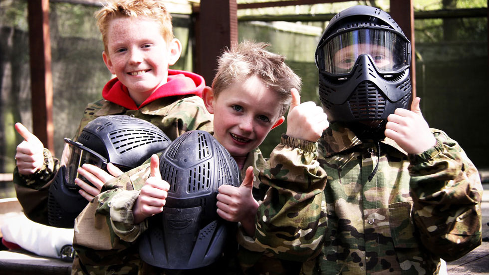 3 happy mini paintballers