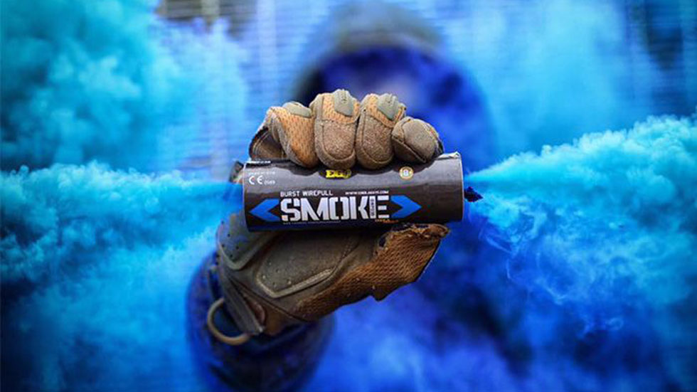 enola gaye smoke grenades showing blue smoke