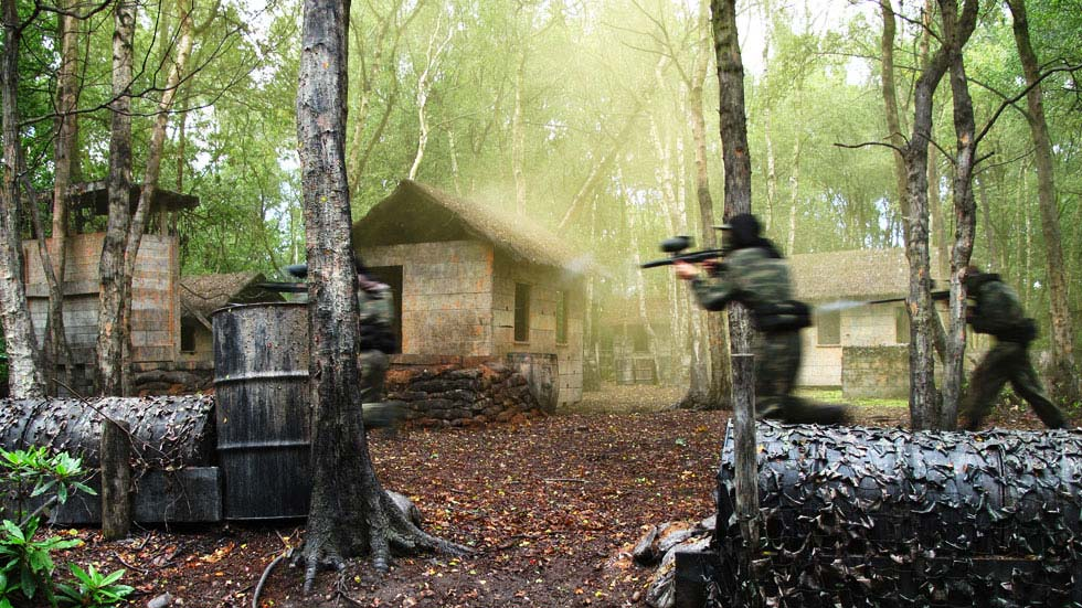 two players attack paintball base in rescue rambo game zone