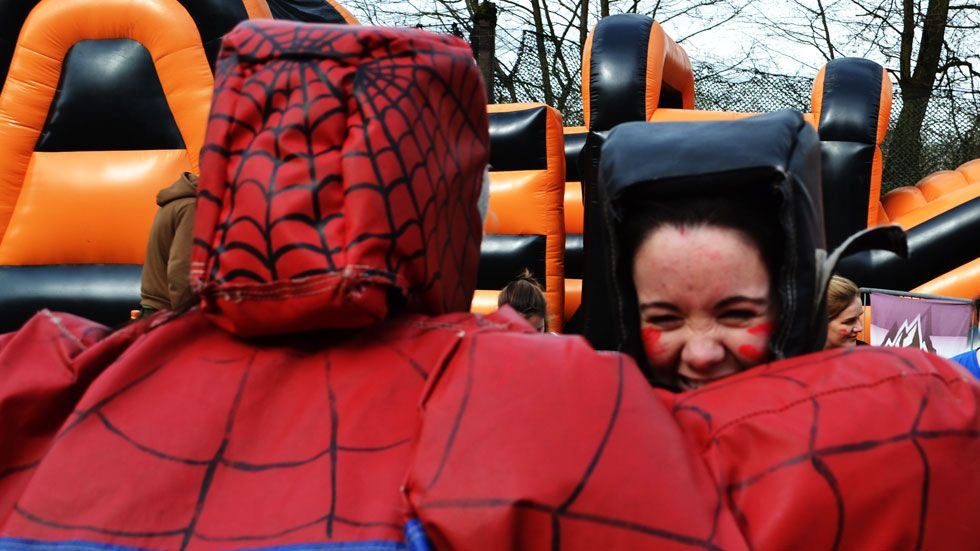 laughing hens in inflatable superhero sumo suits