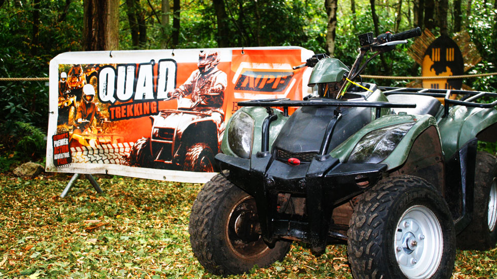 quad bike in front of quad trekking sign