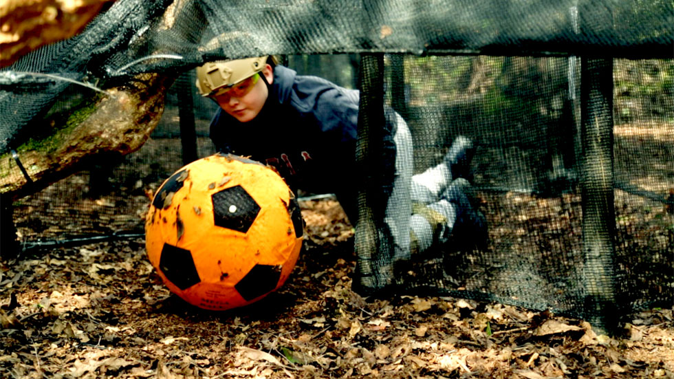 player negotiating a football under ropes
