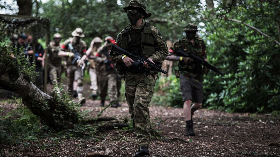 group of walk on airsoft players leaving start point
