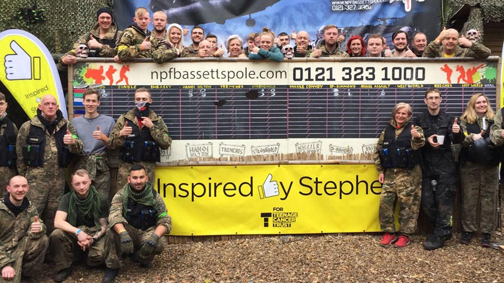 stephens story group poses in front of their banner