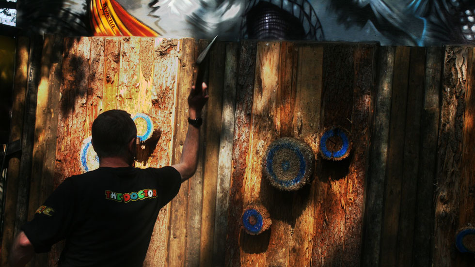 over shoulder view of axe throwing range