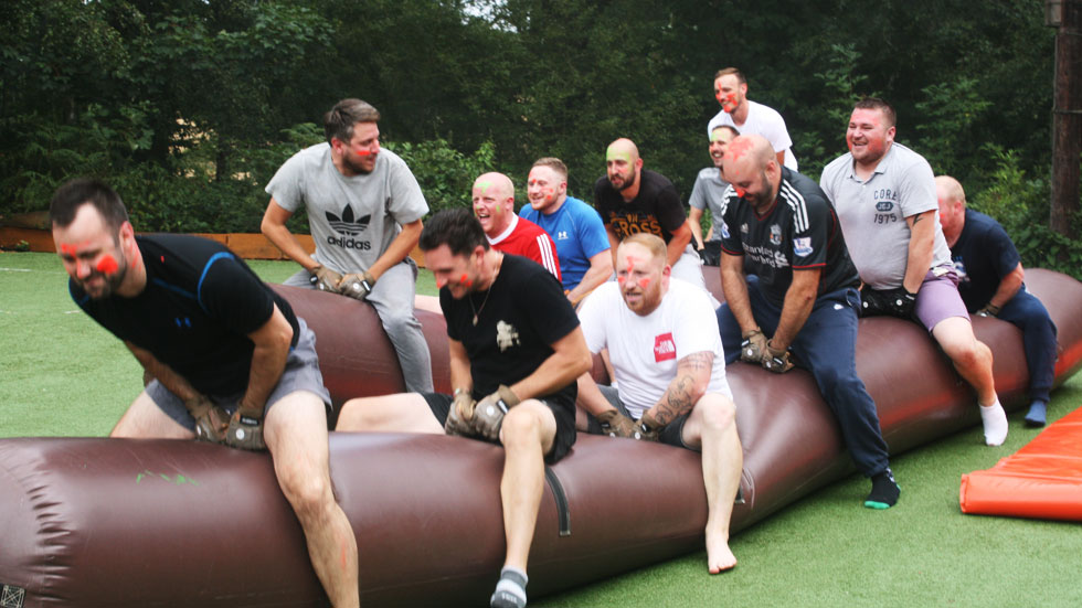 stag group rides the wobbly sausage inflatable