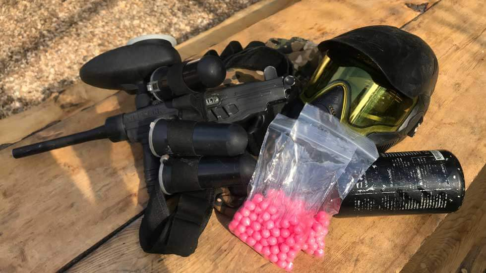 low impact paintball equipment including mask, gun, paintballs, hopper, and belt pack
