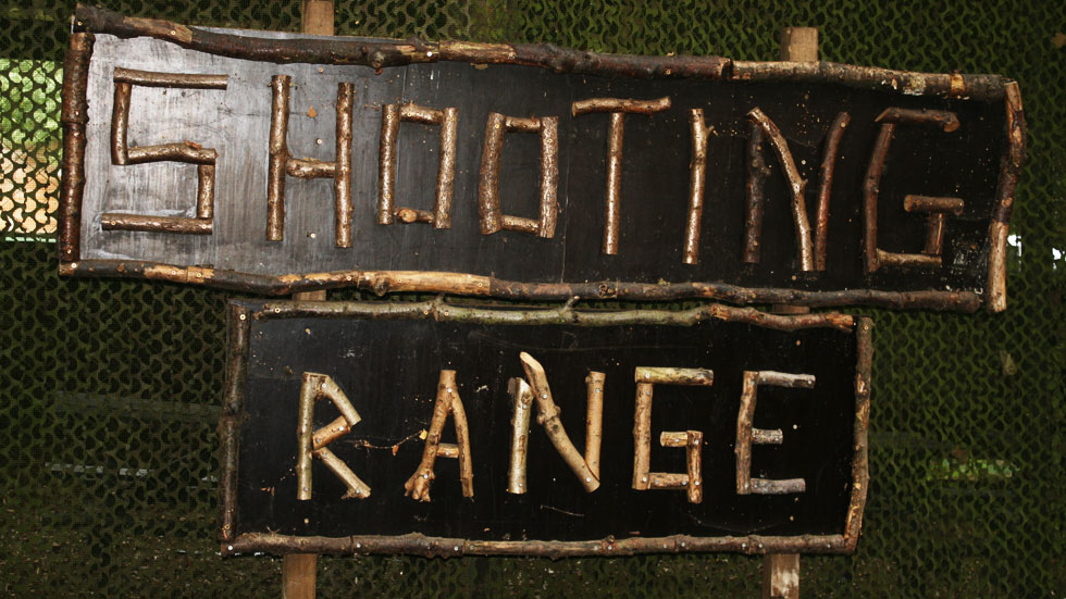 pistol shooting range sign