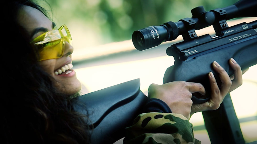 happy player with rifle and eye protection