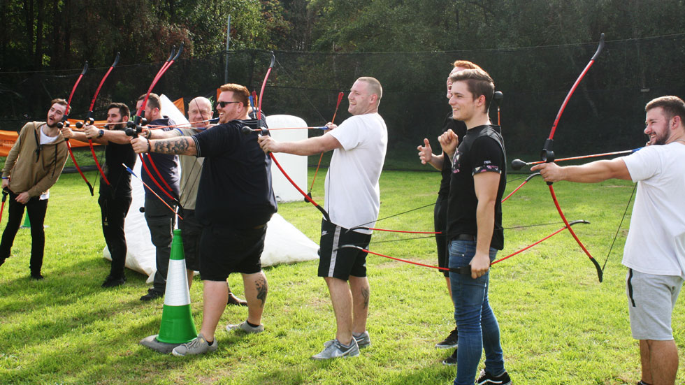 row of battle archers shooting at targets