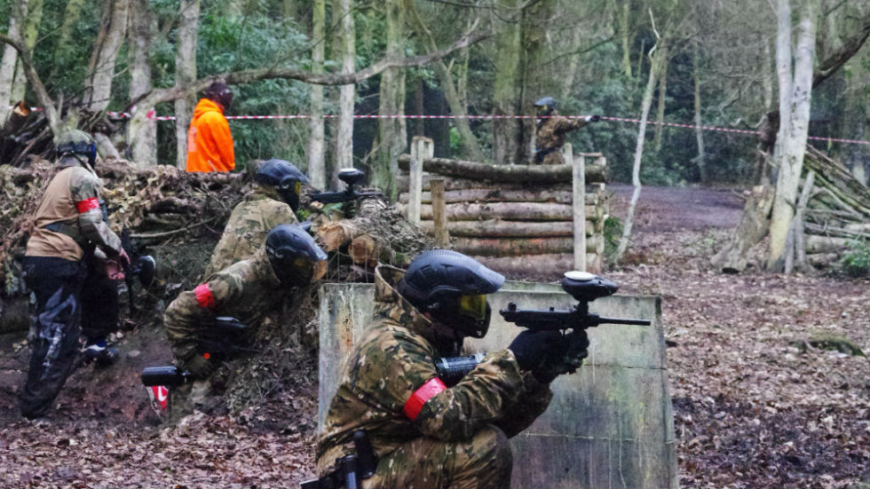 paintballers defending from behind barricades
