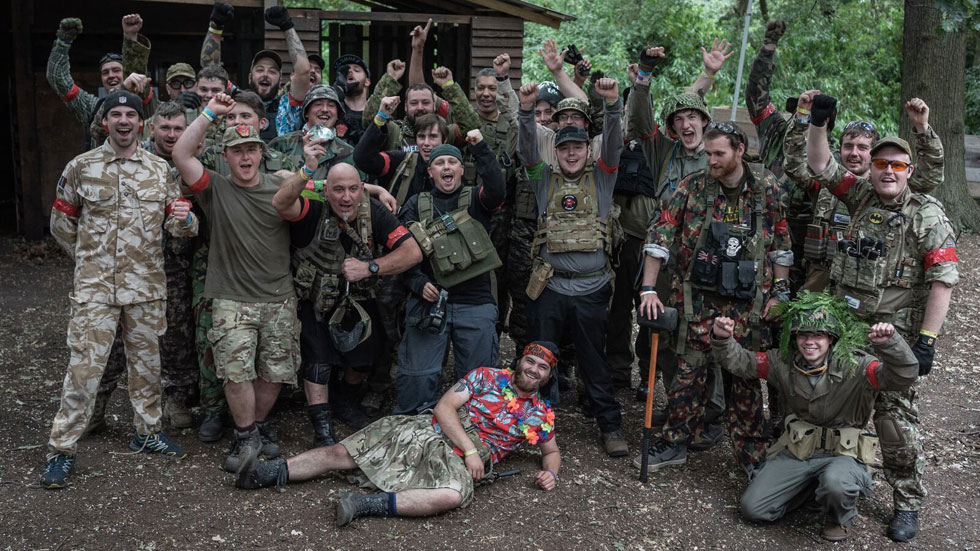 stag group of airsoft players in row with stag in fancy dress