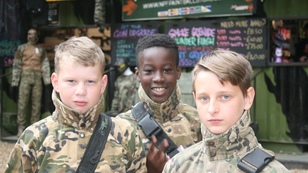 junior players in paintball gear