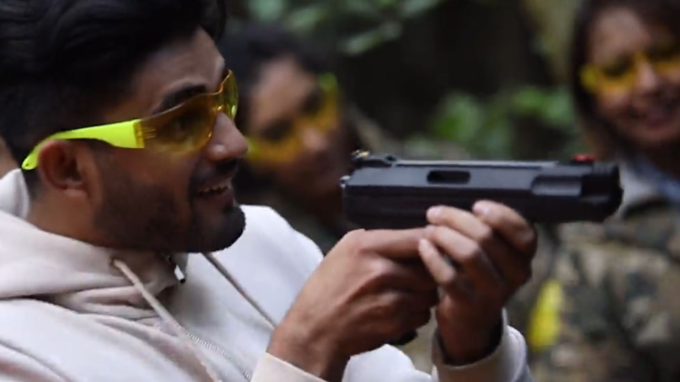 player wearing eye protection shooting air pistol