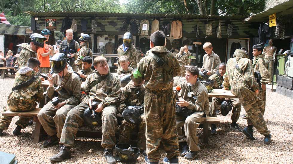 group of junior airsoft players sitting in the base camp area