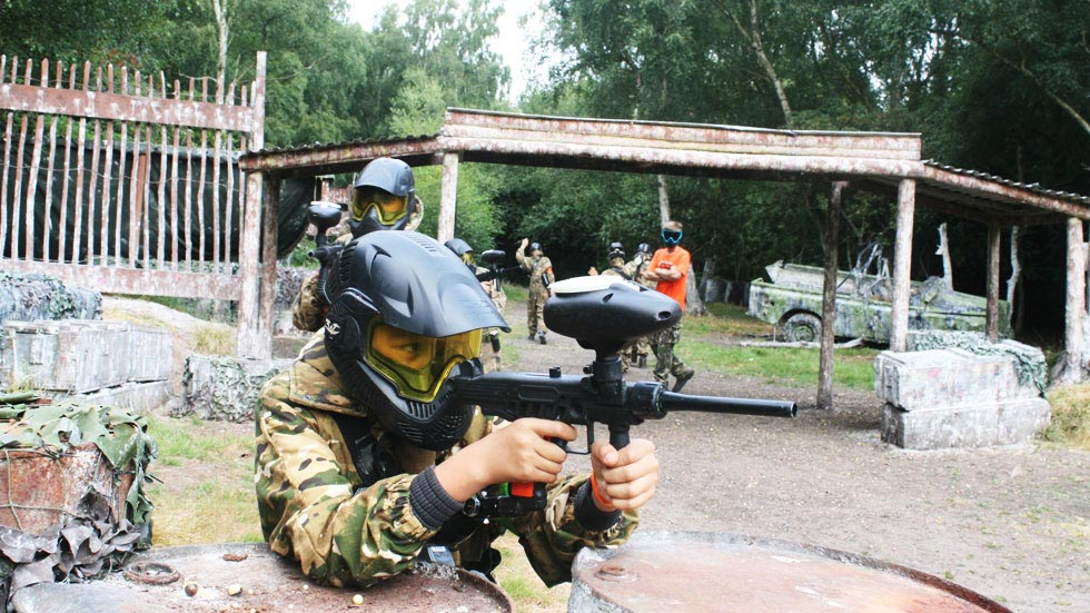 young paintballer in combat