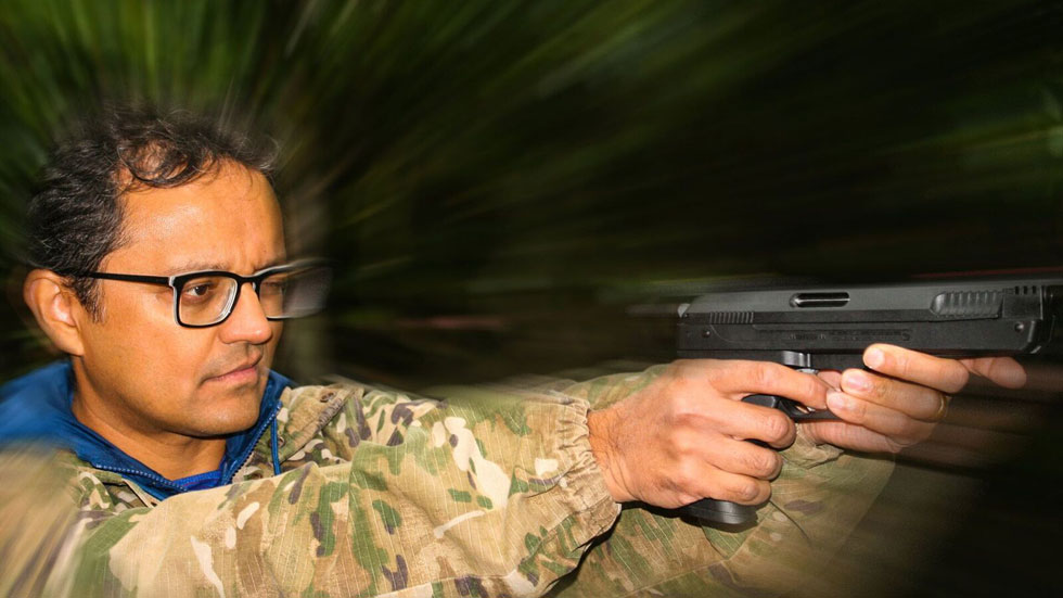 man holding air pistol at arms length