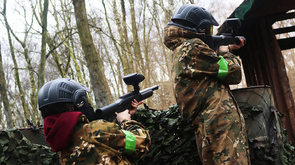 two young players in paintball combat