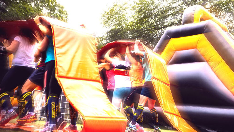corporate groups compete in inflatables game