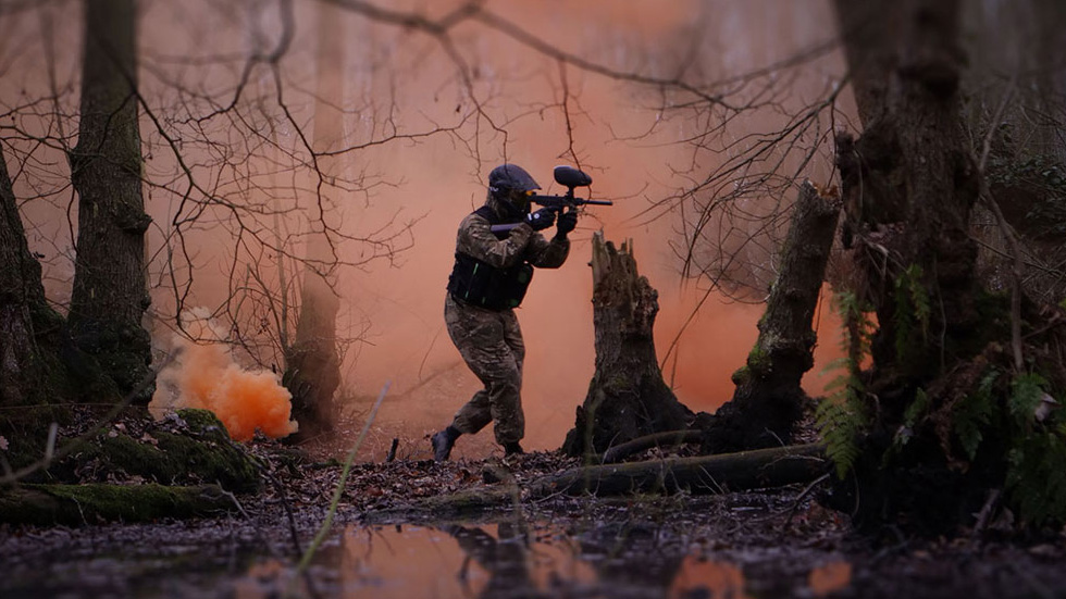 stag playing paintball iin woodland